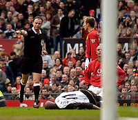 Photo. Jed Wee.<br /> Manchester United v Fulham, FA Cup, Old Trafford, Manchester. 06/03/2004.<br /> Referee Rob Styles (L) awards Fulham a penalty after Luis Boa Morte is brought down in the penalty area.