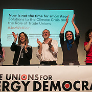 The panel is cheered by a full house after the event. A panel of speakers amongst others Jeremy Corbyn and Naomi Klein speak at an event organised by The Trade Unions for energy Talks in Paris, coinciding with the COP21.