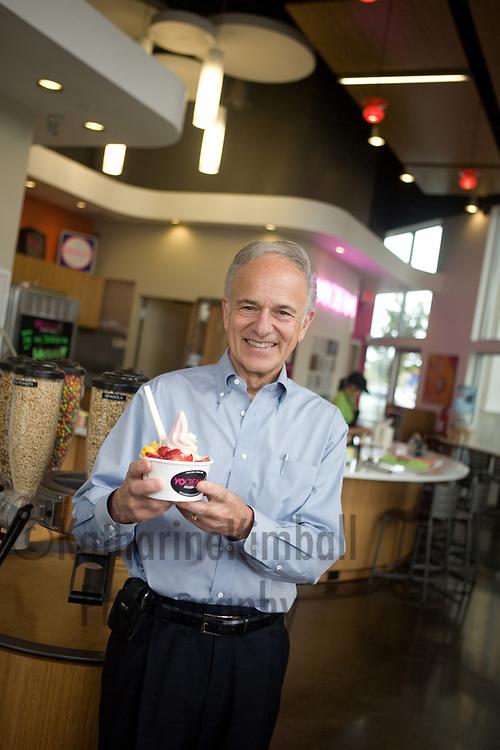 John Hanna, CEO of Yo Cream Inernational, inside the company's store at Cascade Station.