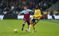 Arsenal's Ainsley Maitland-Niles and West Ham United's Pablo Fornals<br /> <br /> Photographer Rob Newell/CameraSport<br /> <br /> The Premier League - West Ham United v Arsenal - Monday 9th December 2019 - London Stadium - London<br /> <br /> World Copyright © 2019 CameraSport. All rights reserved. 43 Linden Ave. Countesthorpe. Leicester. England. LE8 5PG - Tel: +44 (0) 116 277 4147 - admin@camerasport.com - www.camerasport.com