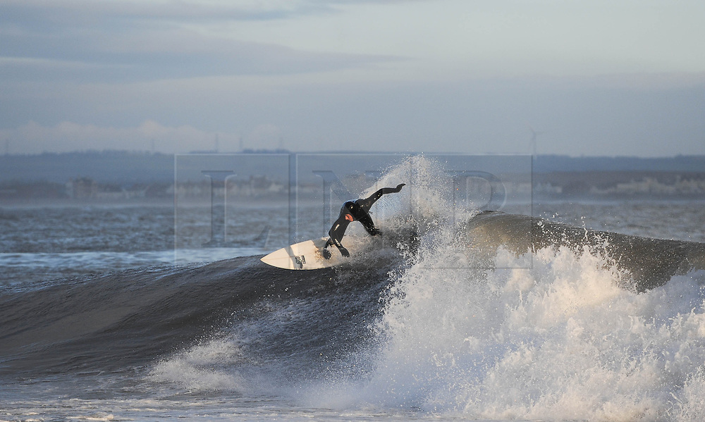 © Licensed to London News Pictures. 27/03/2014<br /> <br /> Cleveland, England<br /> <br /> Surfer Kris Fairest from Saltburn rides a wave on the north east coast of England during an early morning surf.<br /> <br /> Photo credit : Ian Forsyth/LNP