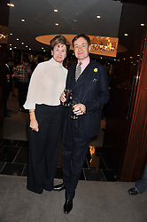 NICK & ALEX FOULKES at the launch of Samsung's NX Smart Camera at charity auction with David Bailey in aid of Marie Curie Cancer Care at the Bulgari Hotel, 171 Knightsbridge, London on 14th May 2013.