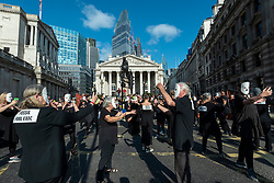 """© Licensed to London News Pictures. 02/09/2021. LONDON, UK.  Climate activists from Extinction Rebellion, as ballroom dancers dancing with their mobile phones and accompanied by an orchestra, stage a Burning Ballroom protest outside the Bank of England to highlight the complicity of the financial industry on climate change.  The event takes place on day eleven of the two week 'Impossible Rebellion' protest to """"target the root cause of the climate and ecological crisis"""".  Photo credit: Stephen Chung/LNP"""