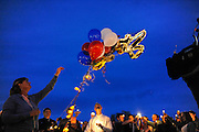 Kate Walker release balloons in the night sky in honor of Diren Dede, a German exchange student, at his vigil on May 2, 2014 at the Fort Missoula soccer field where he played. Kate Walker and her husband, Randy Smith, hosted the student in their Missoula home before he was killed in a shooting by Markus Kaarma, their neighbor.