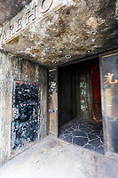 Anata No Warehouse - Your Warehouse is a very unusual, quirky gaming arcade in Kawasaki, like no other in Japan or on Earth for that matter.  The theme, for some reason, is Hong Kong's Kowloon Walled City, in all its grungy detail.  Think: rusting sheet metal, dim flickering florescent lighting, dripping pipes, and filthy windows.  It is ugly on purpose, though nobody knows seems to know or care why.  As you enter the thick metal gates, you emerge into a dark hallway as the one-way door slams behind you, giving you the impression that you are trapped in this den of iniquity.  Naturally, you are indeed free to exit from the back gate, after passing over a slimy pond then through another forbidding metal door clanking behind you forevermore.  Upstairs are plenty of high-tech and retro games, not to mention some Kowloon tenements, including a run-down kitchen, plastic ducks hanging in a fake shop, and even a resting doll woman behind grimy windows.  As unique and macabre as the place is, most of the customers are there for the gaming, with only a handful of sightseers.