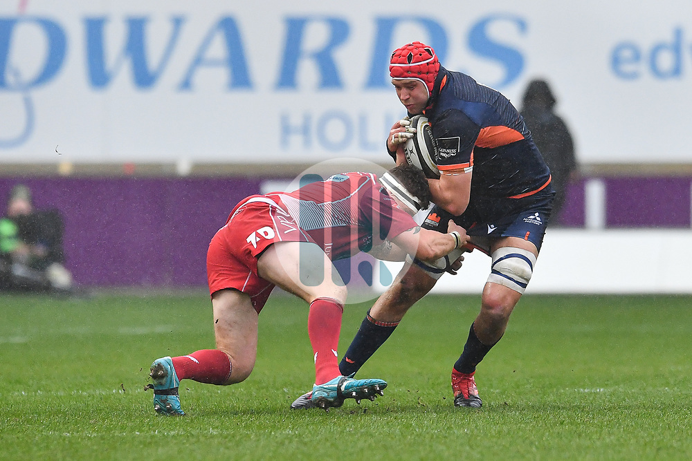 Grant Gilchrist of Edinburgh is tackled by Phil Price of Scarlets<br /> <br /> Photographer Craig Thomas/Replay Images<br /> <br /> Guinness PRO14 Round 11 - Scarlets v Edinburgh - Saturday 15th February 2020 - Parc y Scarlets - Llanelli<br /> <br /> World Copyright © Replay Images . All rights reserved. info@replayimages.co.uk - http://replayimages.co.uk