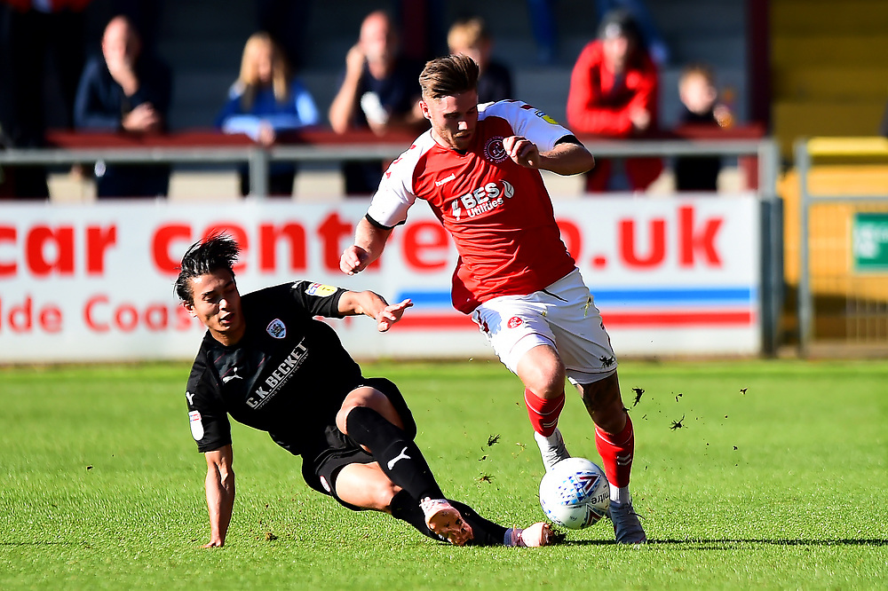 Barnsley's Kenny Dougall challenges Fleetwood Town's Wes Burns  <br /> <br /> Photographer Richard Martin-Roberts/CameraSport<br /> <br /> The EFL Sky Bet League One - Fleetwood Town v Barnsley - Saturday September 29th 2018 - Highbury Stadium - Fleetwood<br /> <br /> World Copyright © 2018 CameraSport. All rights reserved. 43 Linden Ave. Countesthorpe. Leicester. England. LE8 5PG - Tel: +44 (0) 116 277 4147 - admin@camerasport.com - www.camerasport.com