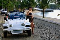 beautiful women with a buggy car in the typical brazilian city of buzios near rio de janeiro in brazil
