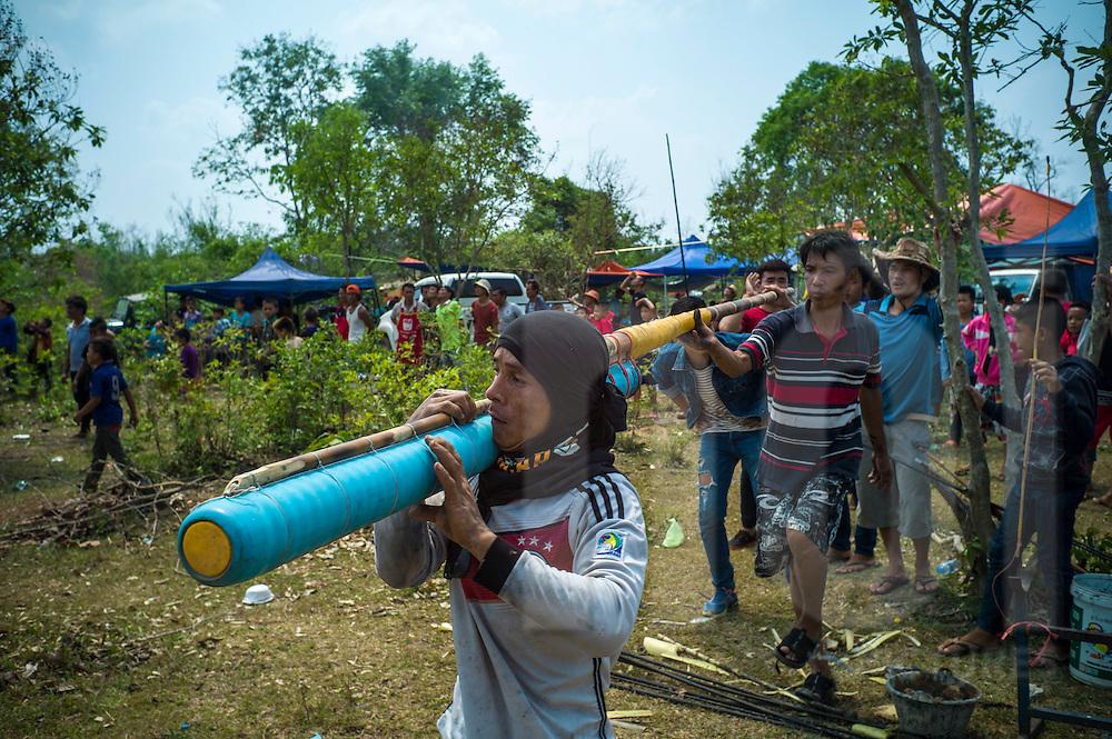 Contestants carry their rocket during Boun Bang Fai, aka Rocket Festival, Ban Don Nieng, a small village near Vientiane, Laos, Southeast Asia