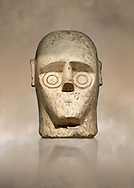 9th century BC Giants of Mont'e Prama Nuragic stone head from the statue of a boxer, Mont'e Prama archaeological site, Cabras. Museo archeologico nazionale, Cagliari, Italy. (National Archaeological Museum) - Art Background .<br />  <br /> If you prefer to buy from our ALAMY STOCK LIBRARY page at https://www.alamy.com/portfolio/paul-williams-funkystock/nuragic-artefacts.html - Type intoo the LOWER SEARCH WITHIN GALLERY box to refine search by adding background colour, etc<br /> <br /> Visit our NURAGIC PHOTO COLLECTIONS for more photos to download or buy as wall art prints https://funkystock.photoshelter.com/gallery-collection/Nuragic-Nuraghe-Towers-Nuragic-Artefacts-of-Sardinia-Pictures-Images/C0000M6ZtTuHVsSo