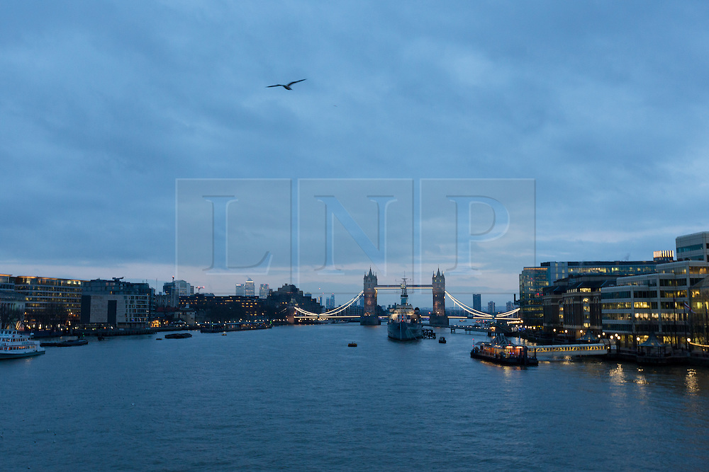 """© Licensed to London News Pictures. 18/01/2016. London, UK. Cloudy blue grey sky behind Tower Bridge in London at sunrise this morning. Today, known as """"Blue Monday"""" is meant to be the most depressing day of the year. Photo credit : Vickie Flores/LNP"""