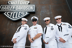 USS South Dakota's Petty Officer Dave Garrett with three of his Naval crew members at the Harley-Davidson rally point during the annual Sturgis Black Hills Motorcycle Rally. Their Virignia class submarine will be commisioned Spring 2018. SD, USA.  August 8, 2016.  Photography ©2016 Michael Lichter.