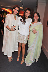 Left to right, ANGIE HEMNANI, MALIKA HEMNANI and PAMELA GROVER at the launch of the India Fantastique Exhibition and book launch featuring photographs by Ram Shergill and fashion by India's leading couturiers Abu Jani and Sandeep Khosla held at Sotheby's, 34-35 New Bond Street, London on 5th September 2012.