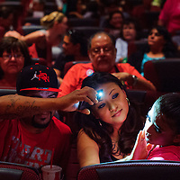 053014       Cable Hoover<br /> <br /> Dancer Hailey Martinez has her makeup done by her mother Zeleste Romero, center, with the help of a cell phone lamp held by Dominic Garcia Friday at El Morro Theatre. Martinez was preparing for her part the World of Dance performance.