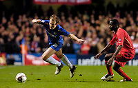 Photo: Leigh Quinnell.<br /> Chelsea v Liverpool. UEFA Champions League. <br /> 06/12/2005. Chelseas Arjen Robben leaves Liverpools Djimi Traore behind.