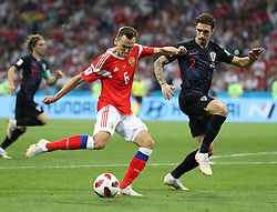 SOCHI, July 7, 2018  Denis Cheryshev (L front) of Russia vies with Sime Vrsaljko of Croatia during the 2018 FIFA World Cup quarter-final match between Russia and Croatia in Sochi, Russia, July 7, 2018. (Credit Image: © Xu Zijian/Xinhua via ZUMA Wire)