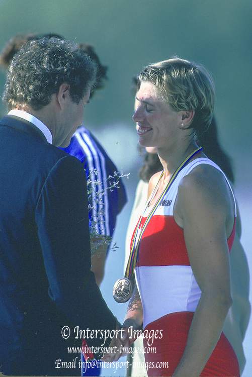 Barcelona Olympic Games 1992<br /> Olympic Regatta - Lake Banyoles<br /> Bronze medalist, CAN W1X, Silken LAUMANN, recieves a handshake from Dennis OSWALD FISA President,  on awards dock.; Women's Single Medals,  {Mandatory Credit: © Peter Spurrier/Intersport Images]