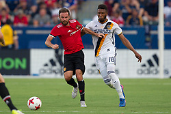 July 15, 2017 - Carson, California, U.S - Manchester United F Juan Mata (8) and Los Angeles Galaxy D Bradley Diallo (18) in action during the summer friendly between Manchester United and the Los Angeles Galaxy at the StubHub Center. (Credit Image: © Brandon Parry via ZUMA Wire)