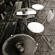 A cafe scene in Paris, France, as chairs and tables line the pavement in symmetry. Paris, France, 28th February 2011 .