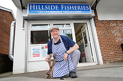 © Licensed to London News Pictures. 29/07/20. Ackworth, UK. Charlie Tipton, owner of Hillside Fisheries chip shop in Ackworth, West Yorkshire is offering free fish and chips to anyone who arrives wearing a flat cap and is accompanied by their pet whippet on Yorkshire Day on  Saturday August 1st. <br />Charlie is pictured with Misty the whippet . <br />Yorkshire Day was set up in 1975 by the Yorkshire Ridings Society to celebrate and promote Yorkshire culture. <br />Picture Credit: Scott Merrylees/LNP