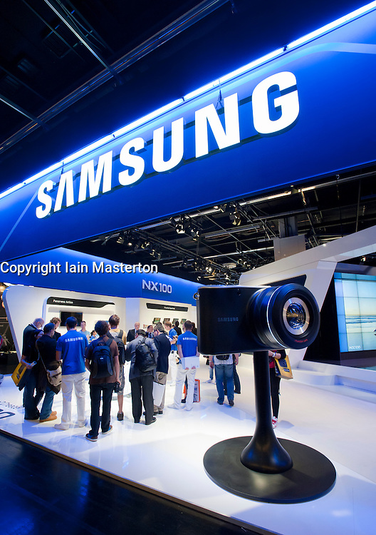 Samsung display stand at Photokina digital imaging trade show in Cologne Germany