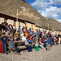 South America, Latin America, Peru, Urubamba Valley. Locals gather for a Sunday festival event in Ollanta (Olantaytambo).