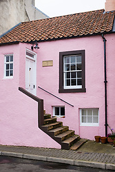 Old pink house in St Monans village on in East Neuk of Fife in Scotland, United Kingdom