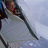 Baffin Island, Nunavut, Canada. Looking out of a hanging tent, high up on Great Sail Peak.