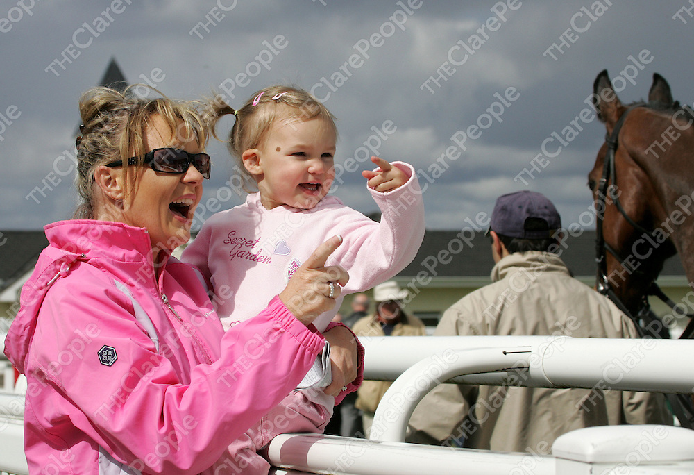 2 year old Meg Coote with her mother Mary-Lou Moylan from Ennis Co Clare check out the parade ring prior to racing at Limerick Racecourse Patrickswell Co Limerick on Monday.Pic Arthur Ellis/Press 22.