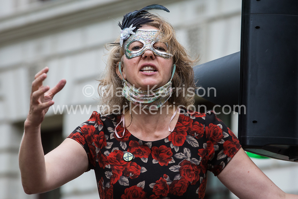Dr Gail Bradbrook, co-founder of Extinction Rebellion, addresses fellow climate activists at a 'Carnival of Corruption' protest outside the Treasury against the government's facilitation and funding of the fossil fuel industry on 3 September 2020 in London, United Kingdom. Extinction Rebellion activists are attending a series of September Rebellion protests around the UK to call on politicians to back the Climate and Ecological Emergency Bill (CEE Bill) which requires, among other measures, a serious plan to deal with the UK's share of emissions and to halt critical rises in global temperatures and for ordinary people to be involved in future environmental planning by means of a Citizens' Assembly.