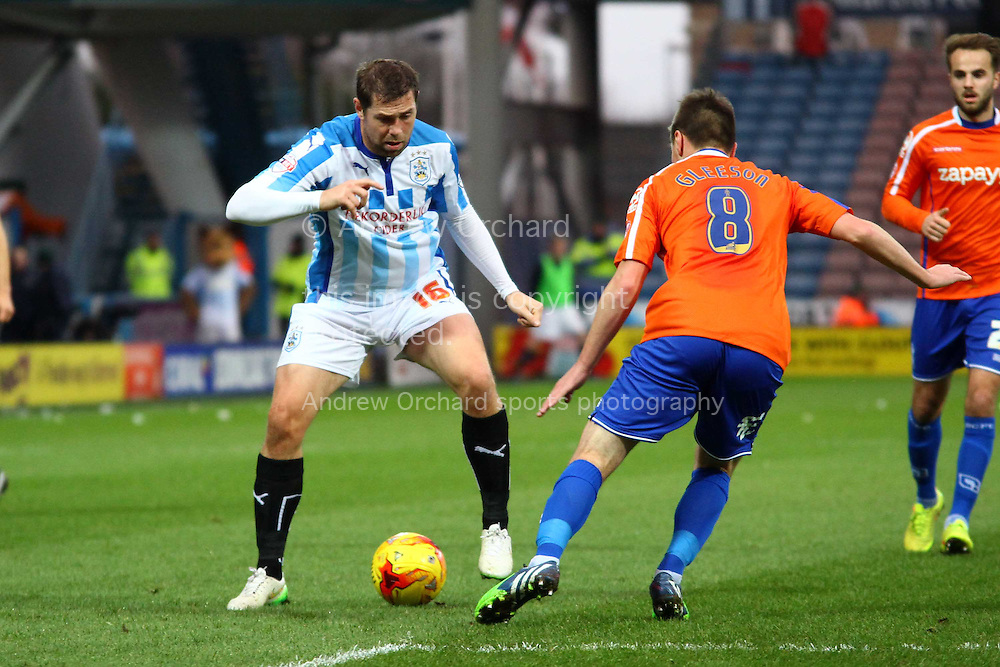 Grant Holt of Huddersfield Town looks to go past Stephen Gleeson of Birmingham City. Skybet football league championship match, Huddersfield Town v Birmingham city at the John Smith's stadium in Huddersfield, Yorkshire on Saturday 20th December 2014.<br /> pic by Chris Stading, Andrew Orchard sports photography.