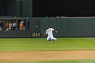 Minnesota Twins center fielder Denard Span #2 makes a sliding catch against the Baltimore Orioles at Target Field in Minneapolis, Minnesota on July 16, 2012.  The Twins defeated the Orioles 19 to 7 setting a Target Field record for runs scored by the Twins.  © 2012 Ben Krause
