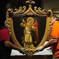 PADOVA, ITALY - APRIL 13:  Two technicians move one of the Angels paintings by Guariento which will be on display on April 13, 2011 in Padova, Italy. The Guariento exhibition will be open from April 16th until July 31st in the renovated Foundation Cariparo in Piazza del Duomo.