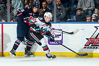KELOWNA, BC - MARCH 7: Chase Wheatcroft #26 of the Lethbridge Hurricanes back checks Kyle Topping #24 of the Kelowna Rockets at Prospera Place on March 7, 2020 in Kelowna, Canada. (Photo by Marissa Baecker/Shoot the Breeze)