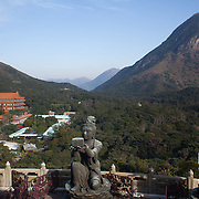 Tourists visit the Giant Buddha at Po Lin Monastery near Ngong Ping village.