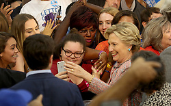 Hillary Clinton poses for photos after her speech at Miami Dade College in Kendall with former Vice President Al Gore. The two discussed climate change as well as the upcoming election. Miami, FL, USA, October 11, 2016. Photo by Mike Stocker/Sun-Sentinel/TNS/ABACAPRESS.COM