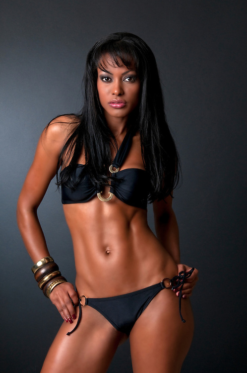 Hot model in posing in black bikini, studio shot.