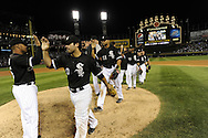 CHICAGO - AUGUST 27:  Andruw Jones #25 and Carlos Quentin #20 of the Chicago White Sox celebrate with teammates after the game against the New York Yankees on August 27, 2010 at U.S. Cellular Field in Chicago, Illinois.  The White Sox defeated the Yankees 9-4.  (Photo by Ron Vesely)