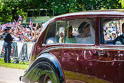 Meghan Markle drives down the Long Walk on the procession route ahead of the royal wedding. Windsor, May 19 2018.