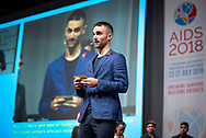 22nd International AIDS Conference (AIDS 2018) Amsterdam, Netherlands.  <br /> Copyright: Steve Forrest/Workers' Photos/ IAS<br /> <br /> Photo shows: Quinn Tivey, The Elizabeth Taylor AIDS Foundation, United States, opening the #PassTheMic: Meaningful youth participation in the fight against HIV Moderated discussion, with youth participants from Amsterdam Youth Force, Charlize Theron Africa Outreach Project, Elizabeth Glaser Pediatric AIDS Foundation, the Elizabeth Taylor AIDS Foundation, the International AIDS Society, Avert, Teenergizer and Youth Against AIDS.