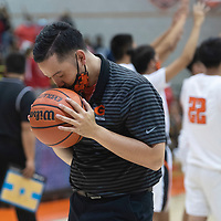 Gallup Bengals head coach Joshua Dunlap kisses the game ball after defeating the Bernalillo Spartans 70-67 in the New Mexico Class 4A boys basketball quarterfinal game Tuesday evening in Gallup.