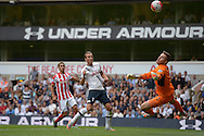 Harry Kane of Tottenham Hotspur tries to shoot past the Stoke city goalkeeper Jack Butland but the Stoke keeper saves . Barclays Premier league match, Tottenham Hotspur v Stoke city at White Hart Lane in London on Saturday 15th August 2015.<br /> pic by John Patrick Fletcher, Andrew Orchard sports photography.