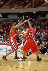 03 February 2007: Levi Dyer attempts to squeeze between Zach Andrews and J.J. Tauai to get to the bucket. In what is locally referred to as the War on Seventy Four, the Bradley Braves defeated the Illinois State University Redbirds 70-62 on Doug Collins Court inside Redbird Arena in Normal Illinois.