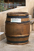 A wine barrel with a sign indicating the toilettes toilets rest men's wash rooms. The restaurant Le Verger de Papes in Chateauneuf-du-Pape Châteauneuf, Vaucluse, Provence, France, Europe