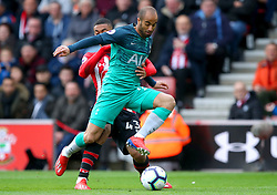Southampton's Yan Valery (back) and Tottenham Hotspur's Lucas Moura battle for the ball during the Premier League match at St Mary's Stadium, Southampton.