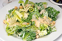 Traditional caesar salad with parmigiana crostoni.