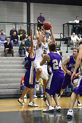 30 December 2006: Andrew Freeman rises above the defense for a shot. The Titans outscored the Britons by a score of 94-80. The Britons of Albion College visited the Illinois Wesleyan Titans at the Shirk Center in Bloomington Illinois.<br />
