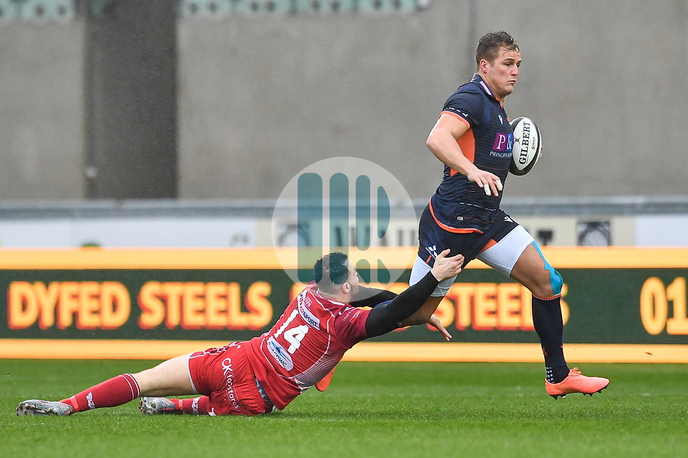 Duhan van der Merwe of Edinburgh evades the tackle of Ryan Conbeer of Scarlets<br /> <br /> Photographer Craig Thomas/Replay Images<br /> <br /> Guinness PRO14 Round 11 - Scarlets v Edinburgh - Saturday 15th February 2020 - Parc y Scarlets - Llanelli<br /> <br /> World Copyright © Replay Images . All rights reserved. info@replayimages.co.uk - http://replayimages.co.uk