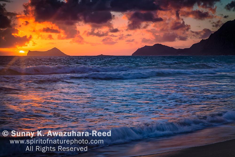 Sunrise over Rabbit Island and Bellows Beach. Oahu Island, Hawaii.