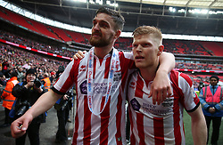 Lincoln City's Luke Waterfall and Elliott Whitehouse celebrates at full time during the Checkatrade Trophy final at Wembley Stadium, London